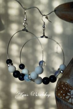Earings with Sunstone, Opal, white coral and crystals.