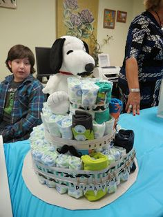 It's A Party-ful Life! Snoopy diaper cake with diapers, blankets, and outfits-so cute! great idea for baby shower gift Snoopy Cake, Baby Snoopy, Baby Shower Diapers, Baby Shower Gifts, Diaper Cake Boy, Diaper Cakes, Diaper Castle, Monsters Inc Baby Shower, Snoopy And Woodstock