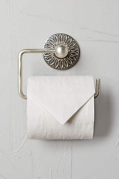 Floral Imprint Toilet Paper HolderBeautiful bath accessories from Anthropologie.Buy here.