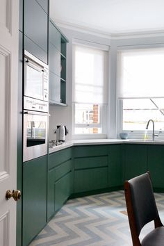 """This kitchen in designer [link url=""""http://smithcreative.net/""""]Mark Smith[/link]'s London flat is a [i]House & Garden[/i] favourite. We have fallen for the [link url=""""http://www.houseandgarden.co.uk/interiors/flooring/chevron-zigzag-floor""""]chevron flooring[/link]. The kitchen worktop, running right around the bay window, makes sure that not a centimetre of space is wasted. The bold flooring pattern is offest by the paler colour, making it the perfect balance in this small but punchy kitchen…"""