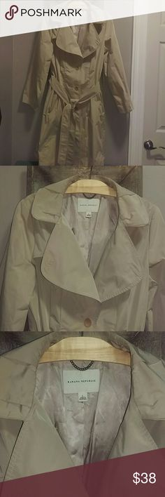 Banana Republic Raincoat Tan colored raincoat with champagne colored inside lining. In excellent condition, no rips in pockets or inner lining. Banana Republic Jackets & Coats Trench Coats