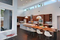 Love how the long integrated bench echoes the high celing window to create a longer, larger kitchen.