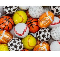 Fill our favors with a special candy like this and you can make a traditional centerpiece into an instant themed centerpiece! Foiled Chocolate Sports Balls - Assortment: 5LB Bag