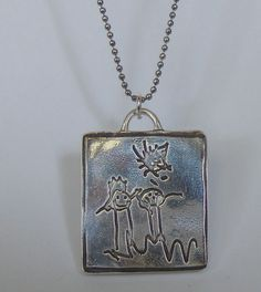 I love that you can put a snippet of song on these, in your own handwriting no less!    level 7 -Pendant-Fully Double Sided Silver Pendant from Your Art or Mine- or Footprints / Handprints / with bail. $170.00, via Etsy.