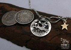 Recycled silver sixpence coin