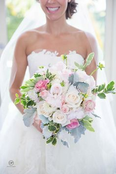 Pastel colors Wedding bouquet by Orth Photography at the Four Seasons Resort Palm Beach.  Wedding details photography