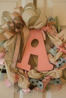 Cute ribbon wreath idea with initial in the middle - no tutorials tho...but pleanty to buy