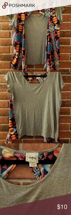 Open back shirt Fun summertime shirt. It has an open back with  an Aztec type print. The front is soft grey. Daytrip Tops Tees - Short Sleeve