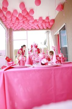 love the balloons on the ceiling and the dessert table in one of the other photos