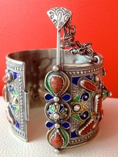 Africa | Vintage Berber bracelet with Coral & Enamel | Great Kabylia, Algeria | Silver, red, orange, blue, green and yellow enamel and red coral.