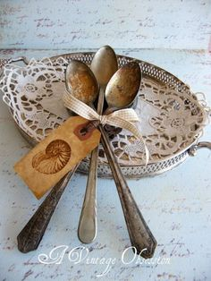 Silver spoons - I'm so glad that nasty man at the junk shop in my home town refused to look at my old tableware...how lovely it will look displayed like this in my china cabinet