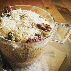 Pumpkin Chia Pudding with Grated Coconut, Dried Cranberries, Walnuts & Pepitas