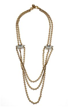 I love how the three chains have a built-in twist in this piece. Lulu Frost - Sunburst Drape Necklace.