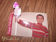 Lollipop Valentine's Day Card. Just take a photo of your kid with arm extended, print, and then use an Xacto knife to cut a slit. Attach lollipop inside his/her hand. Easy!