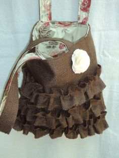 A chocolate brown burlap bag from theruffleddaisy etsy shop is just as sweet as the pink one..decisions!