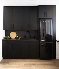 'Blackout' Kitchens Are All the Rage for Good Reason—Here Are 10 to Gawk At - matte black kitchen with polished concrete backsplashes - Black Kitchen Cabinets, Black Kitchens, Home Kitchens, Kitchen Black, Kitchen Appliances, Smeg Kitchen, Modern Kitchen Design, Interior Design Kitchen, Home Design