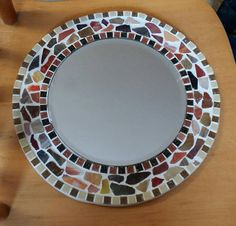Hand made mosaic mirror with shades of brown and cream mosaic. Made with quality mosaic and grout products. A unique item for any room in house especilly bedroom or children's room. The mirror measures and the inner mirror is 20 cm wide. Glass Mosaic Tiles, Mosaic Art, Handmade Mirrors, Mirror Plates, Beautiful Mirrors, Mosaic Projects, Grout, White Ceramics, Picture Frames