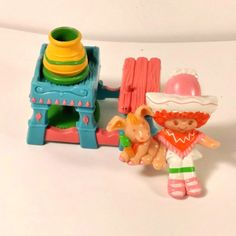 http://www.ebay.com/itm/1980-S-MINI-STRAWBERRY-SHORTCAKE-CAFE-OLE-AT-THE-POTTERS-WHEEL-w-BURRITO-RARE-/162132063734?hash=item25bfd2f5f6:g:QrAAAOSwanRXgkRB