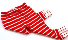 Adorable red and white stripped leggings with green and red dot cuff. Perfect Christmas leggings. These leggings are surged at the seems to