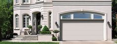 Premium insulated steel garage doors that will help keep your garage comfortable in cold and hot climates. | Flush Design | Thermacore® Collection | Learn more at overheaddoor.com