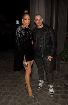 Jennifer Lopez and boyfriend Casper Smart made a hot appearance at the afterparty for the 2015 American Music Awards, held at the Microsoft Theatre in Los Angeles on Nov. 22, where the Puerto Rican singer and actress hosted and performed. The couple, who has been dating on and off for the past four years, stayed closed as they posed for the cameras with J Lo in yet another revealing outfit of a crop top and tight skirt — we'd be fools to expect anything else.