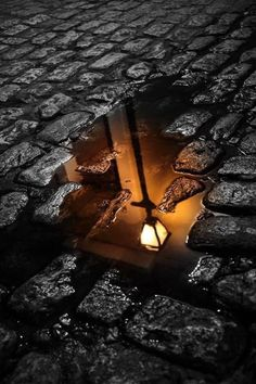 #5 I love how grim this photo is around the puddle. The stark contrast makes the lamp give off a very homely vibe. The soft glow of the lamp is really able to come out within the puddle of water