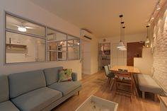 HDB 4-Room Standard Flat. House is mainly covered in warm lightings and wood grain flooring. The textured feature wall gave the entire living rooma more dimension aesthetic look and feel. The conv…