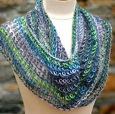 Free Knitting Pattern for Interpretations Infinity Scarf Cowl - I'm fascinated by the look of this scarf / cowl. It's actually easy and the effect of the floating loops of yarn is made by knitting with laceweight yarn alternating with a bulky multi-color yarn. Poncho pattern also included. Designed by Laura Cunitz