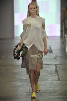 The Trench in Khaki & Nude. Catwalk show with Laura Needle (Womenswear.) Photography: Roger Dean