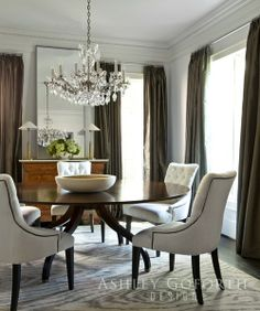 Love this dining room - looks very layered, simple color and round dining table