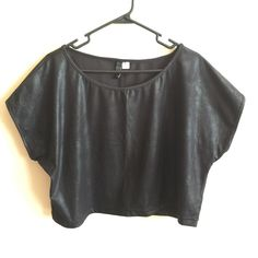 Shiny Crop Top Pre-owned; worn once. Like new condition. Shiny black oversized short sleeve crop top by Divided H&M. Size 12, but can wear anywhere between that and a Size 8. Divided Tops Crop Tops