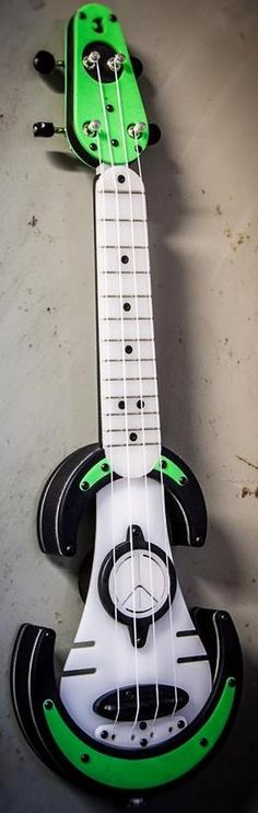 Antica Luthieria UFOS mint green electric Soprano Ukulele --- https://www.pinterest.com/lardyfatboy/