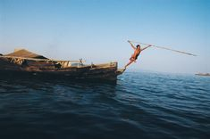 A Moken man spearfishing. From: Photo Center - Asias 25 Places to See Before They Disappear