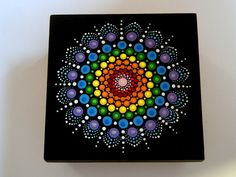 Ready to ship! A beautiful hand painted black wooden jewelry stash box with a large crystal rainbow mandala painted on the removable lid with the pointillism technique, unique small giftable for a best friend birthday, coworker retirement, housewarming gift, or a little treat for yourself to keep your special collections and treasuries in. Hand painted with acrylic paints, coated with a UV protectant and acrylic glaze to protect the surface from fading and moisture. These colors are the…
