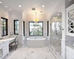 Tuscan bathroom photo in San Francisco with an undermount sink, white cabinets, a freestanding tub, an alcove shower, white tile and white walls