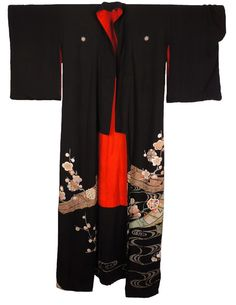 This is a gorgeous silk crepe kimono that I believe dates to the Taisho period (1912-1926), although it is possible that it is late Meiji period. The kimono is known as a trailing Kuro Tomesode or a H