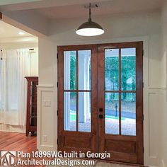 Kitchens with fireplace Plan Flexible Farmhouse with Loads of Outdoor Living Patio Windows, Patio Doors, Home Renovation, Home Remodeling, Double Doors Exterior, Family Room Fireplace, Wood Front Doors, Built In Desk, Everett House