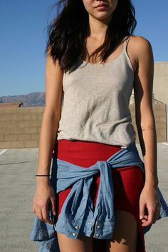 outfit closeup of a red cut out skirt and denim tied at the waist