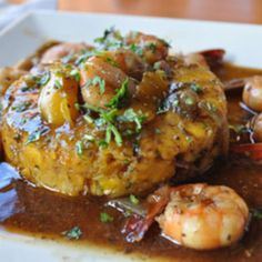 mofongo is a family favorite.it can be served with stewed beef,pork or chicken.its crispy outside and tender inside combine exquisitely with the thick sauce.