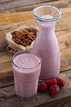 Almond milk and almond butter give this Strawberry Shakeology recipe a delicious, nutty taste. #shakeology #almonds #strawberries #smoothies