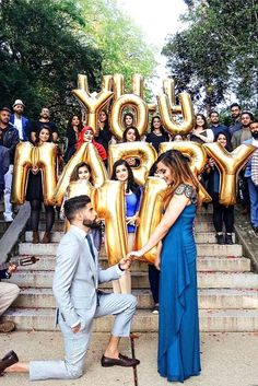 Balloons and friends make this proposal very special.
