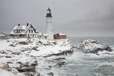 Snow surrounds the Portland Head Light in Cape Elizabeth, Maine.
