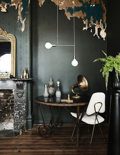 """You've no doubt seen rooms employ a """"pop of color"""" to add interest to a neutral space. There's an endless rainbow of hues that can do the same for you at home, but if you happen to be buying in to 2016's on-trend moody, dark rooms, there's also another unexpected color pop option on the proverbial table: White."""