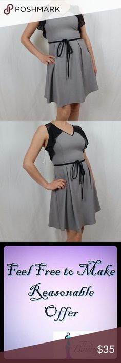 ANTHROPOLOGY ESLEY GREY BLACK DRESS THIS DRESS IS IN LIKE NEW CONDITION.  IT FEATURES SHEER DETAIL ON THE BACK AND SLEEVE AND V NECK LINE WITH TIE WAIST.   BUNDLE DISCOUNTS AVAILABLE.  PLEASE MAKE OFFERS. Esley Dresses Midi