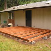 How to Build a Deck With Deck Blocks | eHow  I wonder, I wonder ... could I do this myself without enlisting my busy hubby?