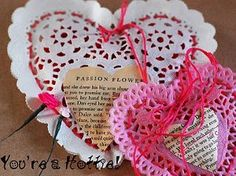 """I cut out book pages with some love words and glued them on the doily. Then, I used a tapestry needle and laced it through the holes leaving an open portion to fill the doily with red hots and finished it off with a bow."""