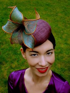 HIBISCUS - small sinamay beret with a two-tone hand-rolled sinamay flower and burnt peacock stamens. GBP 240.00.