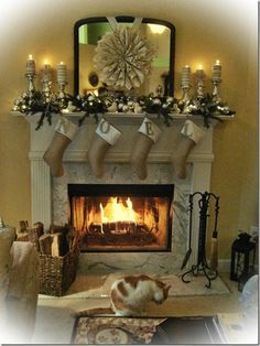 Pretty!  love the book wreath, the burlap stockings, candles wrapped in old pages....