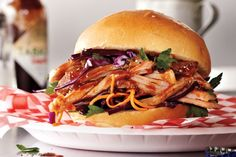 Serve this saucy pulled pork as sandwiches: piled high on buns, with bowls of garnishes, such as pickled jalapeños, sour cream, shredded cheese and thinly shredded red cabbage (or better yet, red cabbage slaw), and let guests build their own sandwiches.