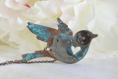 A lot of very cool stuff from this Etsy shop, Steampunk Funk, but I especially like this little bird.